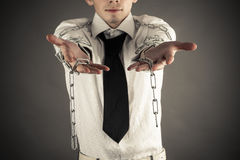 Broken chain. Businessman showing hand with a broken chain Stock Photo