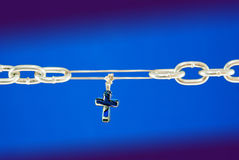 Broken chain connected with a cross Stock Image