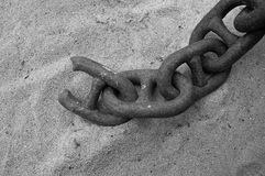 Broken chain. Detail of a old and rusty chain. Broken it is. In black and white this broke chain is still a great scene stock image