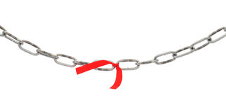 Broken chain isolated. Broken chain with red ribbon isolated on white Stock Photography