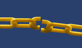 Broken chain link. Close up of broken chain link set against blue sky background for copy text Royalty Free Stock Photo