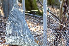Broken chain link fence. In Essen, Germany Royalty Free Stock Images
