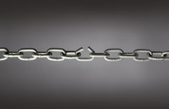 Broken chain. Chain with one link broken Stock Photos
