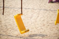 Broken chain swing in playground. / Safety in the playground concept stock photography