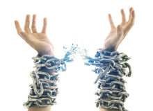 Broken chains. Two hands in chains that are breaking apart