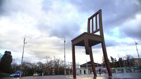 Broken Chair memorial near Palace of Nations, tourists taking photos, panorama. Stock footage stock video