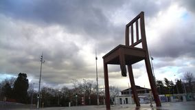 Broken Chair monument in front of Palace of Nations in Geneva, landmark, tourism. Stock footage stock video
