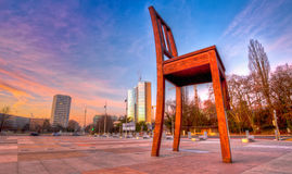 Broken Chair Monument, Geneva HDR. HDR view of the Broken Chair Monument in Geneva Switzerland. Symbolizes the opposition to cluster mine and land mines Stock Images