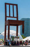 The Broken Chair Monument. Geneva, Switzerland - June 5, 2010: The Broken Chair monument in Geneva, Switzerland.  It is constructed of 5.5 tons of wood and is 12 Royalty Free Stock Photo