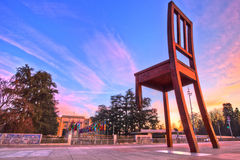 Broken Chair Monument and UN Office, Geneva HDR. Geneva, Switzerland. The Broken Chair, a monument as a symbol of opposition to the use of land and cluster mines Royalty Free Stock Photography