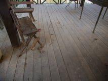 The Broken Chair on a Wooden Floor Stock Image
