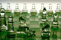 Broken chess piece on a chess board Stock Images