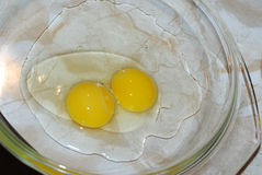 Broken chicken eggs on dish Royalty Free Stock Photo