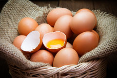 Broken chicken eggs and egg yolk Royalty Free Stock Image