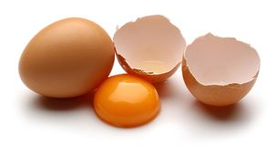 Broken chicken eggs with yolk isolated on white. Background stock image