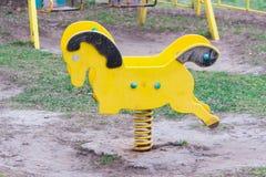 The broken child`s swing. Unhappy childhood Stock Photos