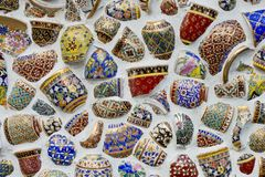 Broken Chinaware decorate on wall. Chinaware background texture Stock Photo