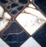 Broken and Chipped Black and White Checked Tiles Royalty Free Stock Images