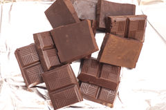 Broken chocolate on a aluminum foil Royalty Free Stock Image