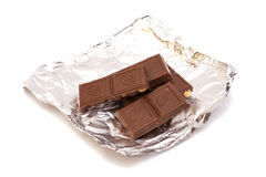 Broken Chocolate bar in foil Royalty Free Stock Photo