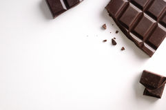 Broken chocolate bar isolated top view Royalty Free Stock Photos