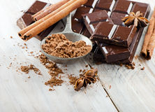Broken chocolate bar and spices . Royalty Free Stock Images