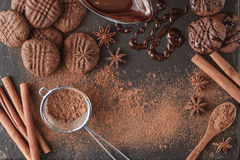 Broken chocolate bar and spices on stone board Stock Images