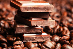 Broken chocolate bar and spices. On wooden table stock photography
