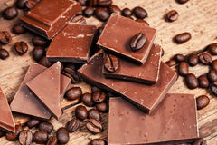 Broken chocolate bar and spices royalty free stock photography