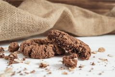 Broken chocolate chip cookie on the table stock image