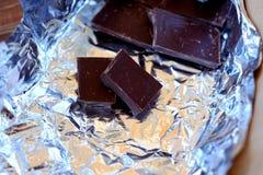 Broken chocolate, dark Stock Images