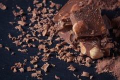 Broken chocolate nuts pieces Royalty Free Stock Photo
