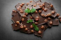 Broken chocolate pieces with hazelnut stock photo