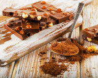 Broken Chocolate on  white  wooden table Royalty Free Stock Photo