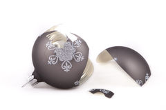 Broken Christmas ornament. Broken, taupe coloured Christmas ornament Royalty Free Stock Photo
