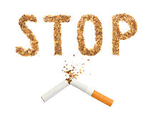 The broken cigaret and word stop made of tobacco Royalty Free Stock Photo