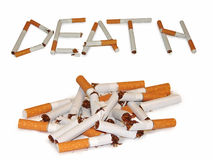 Broken cigarette. A heap of broken cigarettes. And the word, laid with a broken cigarette Royalty Free Stock Photography