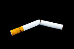 Broken cigarette. A broken cigarette isolated on black, concept of stop smoking (isolated with path Royalty Free Stock Photo