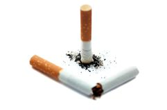 Broken cigarette. Focus on ash. Cigarette with ash and broken cigarette. Focus on ash. Isolated on white. Quit smoke concept stock photography