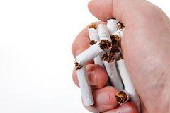 Broken cigarette in hand Stock Photography