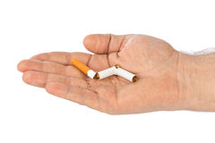 Broken cigarette in hand Stock Image