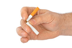Broken cigarette in hand Royalty Free Stock Photography