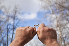 Broken cigarette in his hand Royalty Free Stock Photo