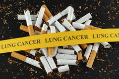 Broken cigarette with message Lung Cancer Stock Photography