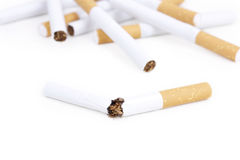 Broken cigarette and some cigarettes Royalty Free Stock Photography