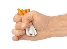 Broken cigarettes in hand Royalty Free Stock Photography