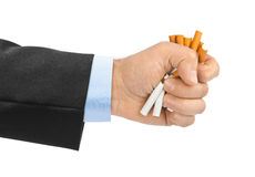 Broken cigarettes in hand Stock Photography