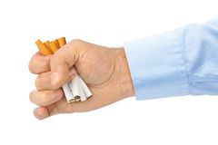 Broken cigarettes in hand Royalty Free Stock Photo