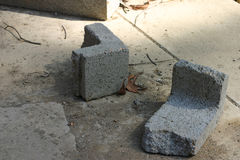 Broken Cinder Block. Two pieces of a broken cinder block on the ground Stock Photography