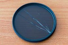 Broken circular polarizing filter. Damaged CPL filter. Broken circular polarizing filter. Damaged CPL filter for camera Royalty Free Stock Image
